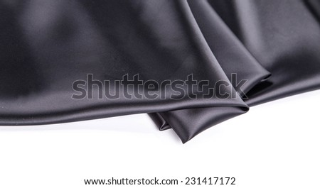 Black silk drapery. Close up. Whole background. - stock photo