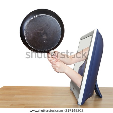 black skillet in female hands leans out TV screen isolated on white background - stock photo