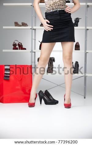 black skirt long legs red high heels - stock photo