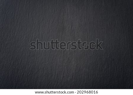 Black slate texture closeup. May be used as background - stock photo