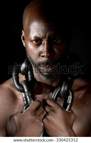Black Slave In Chains - stock photo