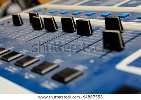 Black sliders on dj console - stock photo