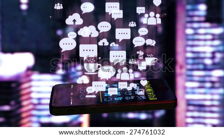 Black smart phone emitting holographic image of social media related icons. Blurred city  lights in the background. - stock photo