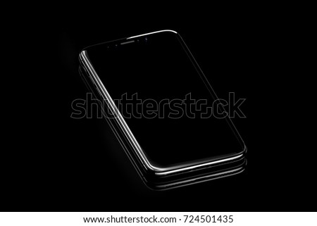 Black smart phone on black glass stock photo royalty free black smart phone on the black glass background with cool reflections in studio voltagebd Choice Image