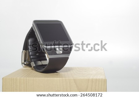 Black Smart watch on wooden box isolated on white background