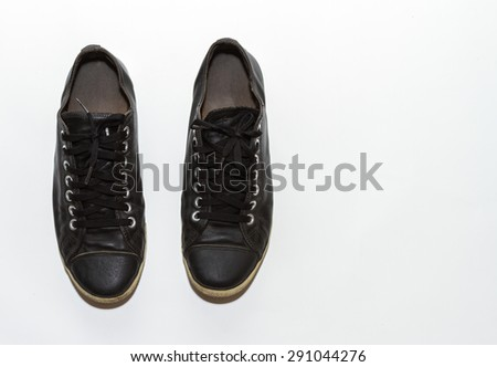 Black sneakers on white background for design. - stock photo