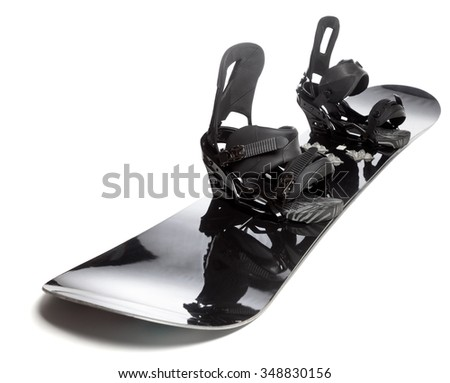 Black snowboard with bindings on white background