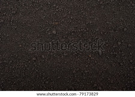 Black soil texture - stock photo