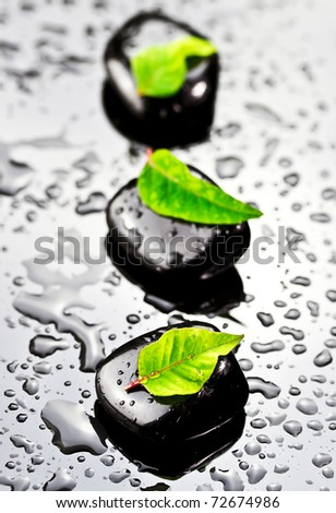 Black SPA stones with water drops