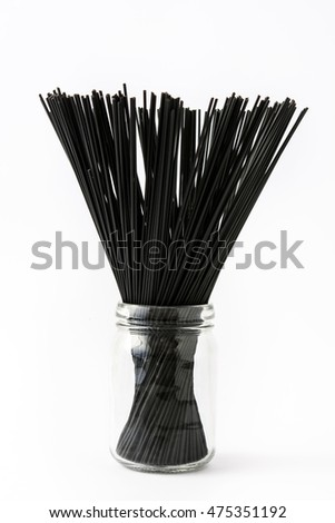 Black spaghetti with prawns isolated on white background