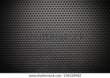 Black speaker lattice background, close-up