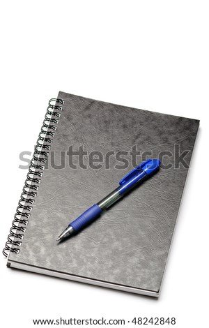 Black spiral notebook and pen isolated on white backround - stock photo