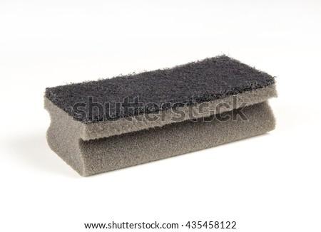 Black sponge on white background - stock photo