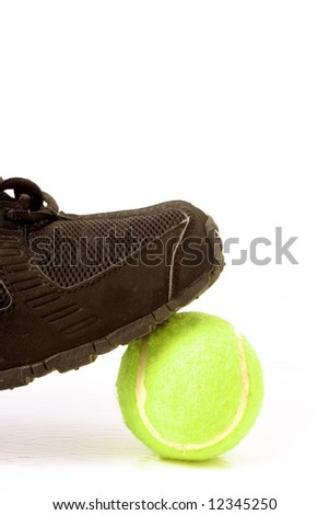 black sports sneaker on green tennis ball