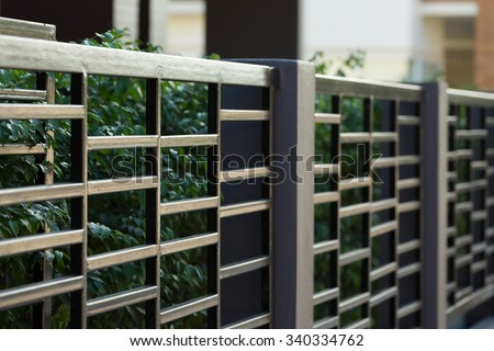 black steel fence of residential house modern style  - stock photo