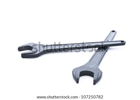 Black steel spanner on white background - stock photo