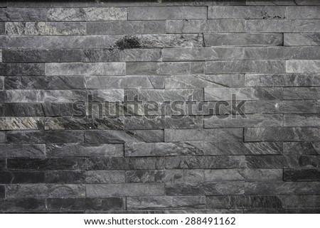 Black stone wall - stock photo