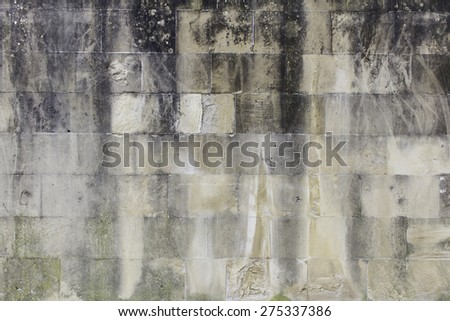 Black stone wall urban street construction - stock photo