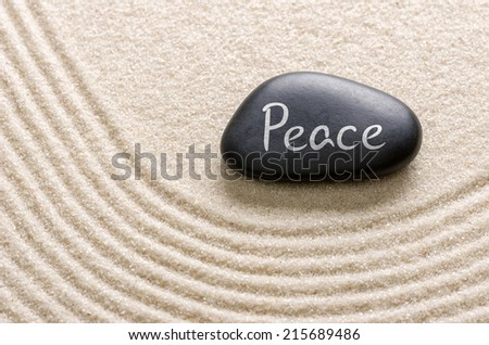 Black stone with the inscription Peace - stock photo