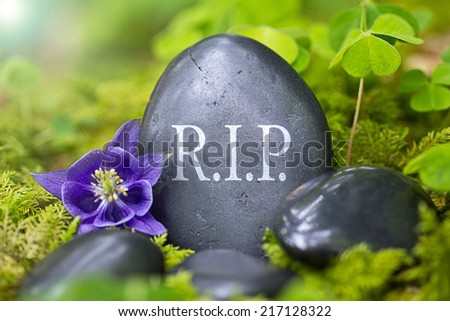 Black stone with the Words ?Rest in Peace? - stock photo