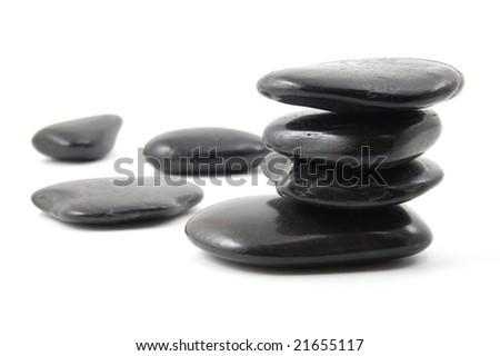 black stones in balance isolated on white background - stock photo