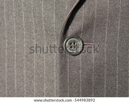 black striped suit fabric texture useful as a background with button