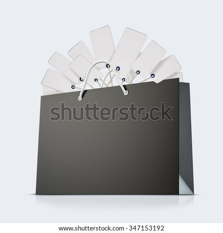 Black strong paper shopping bag with tag on white background