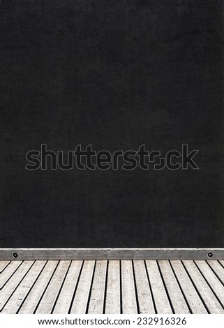 black stucco wall and wooden floor background, chalkboard - stock photo