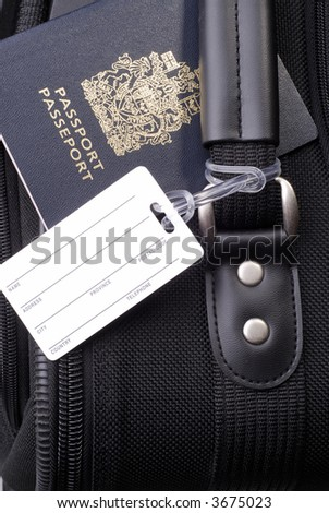Black Suitcase With Blank Luggage Address Label And Canadian Passport - stock photo