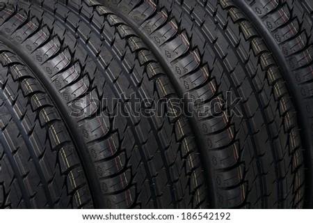 black summer tires close up studio shot - stock photo