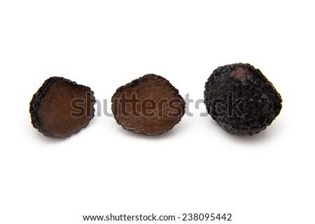 Black summer truffle (Tuber aestivum) or burgundy truffle isolated on a white studio background. - stock photo