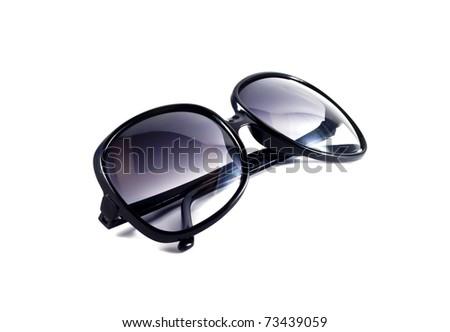 Black sunglasses over white background - stock photo