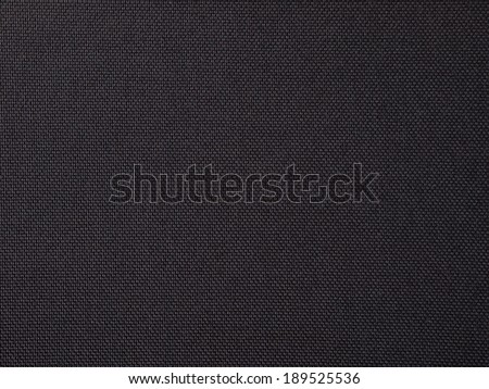 Black synthetic fabric texture background pattern - stock photo