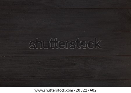 Black table top view of the artist. Empty wooden bench for creative work. Creative minimalism, simplicity and convenience. - stock photo