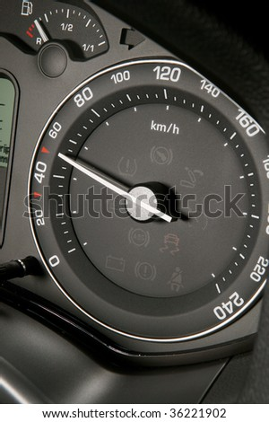 Black tachometer showing lawful speed in the city - stock photo