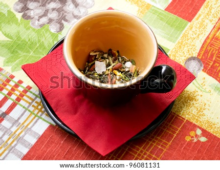Black tea cup on the table cloth color - stock photo