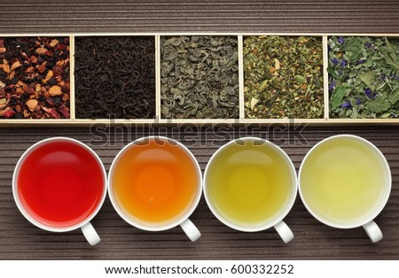 Black tea, green tea, fruit tea cups / tea assortment in boxes