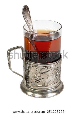 black tea in retro glass with teaspoon and glass-holder isolated on white background - stock photo