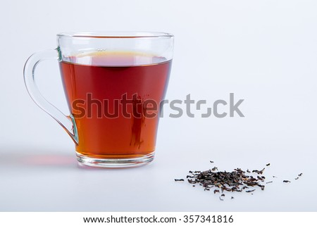 Black tea in the glass cup - stock photo