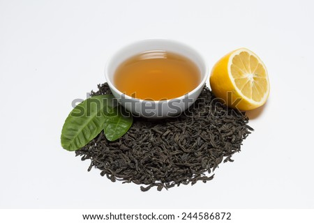 Black tea is poured into a bowl.