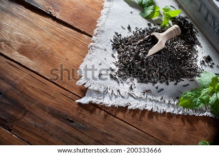 Black tea on wooden table - stock photo