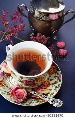 Black tea, vintage style. Still life. - stock photo