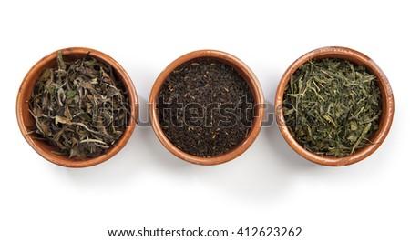 black tea, white tea, green tea in earthenware bowl - stock photo