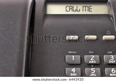 Black telephone detail with numbers and display with message