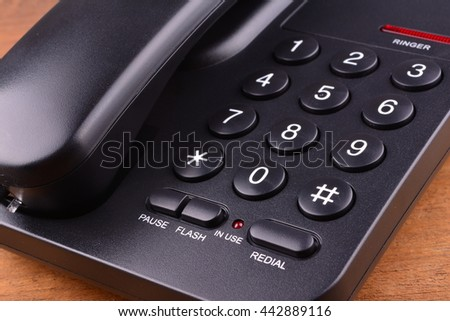 Black Telephone on wooden table