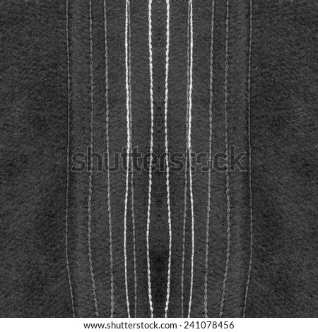 black textile  texture with decorative  seams