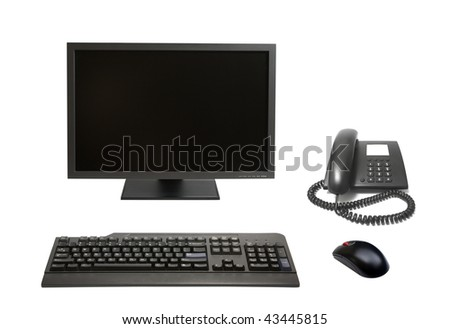 black tft flat monitor, computer mouse, keyboard and office phone isolated on white