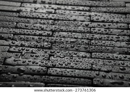 Black tile background with water - stock photo