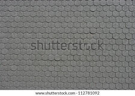 Black tiled roof for background usage - stock photo