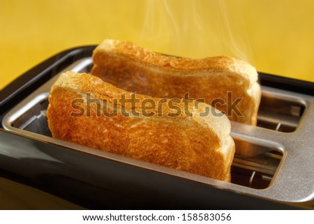 Black toaster with two hot toasts - stock photo